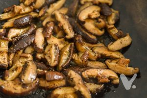 Stir fried shiitake mushrooms as ingredients for vegan glutinous rice dumplings.